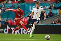 7th July 2021, Wembley Stadium, London, England; 2020 European Football Championships (delayed) semi-final, England versus Denmark;   Pierre Emile HOEJBJERG Hojbjerg DEN shoots pasts John STONES ENG
