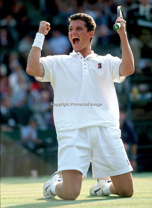 "1996, Wimbledon ""King Richard"" Krajicek beats Washington in the Wimbledon final and goes down on his knees in jubilation"
