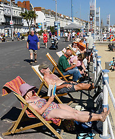 BNPS.co.uk (01202 558833)<br /> Pic: Graham Hunt/BNPS<br /> Date: 7th September 2021.<br /> <br /> Sunbathers flock to the beach to enjoy the scorching hot sunshine at the seaside resort of Weymouth in Dorset.<br /> <br /> Sunbathers in deck chairs on the seafront.