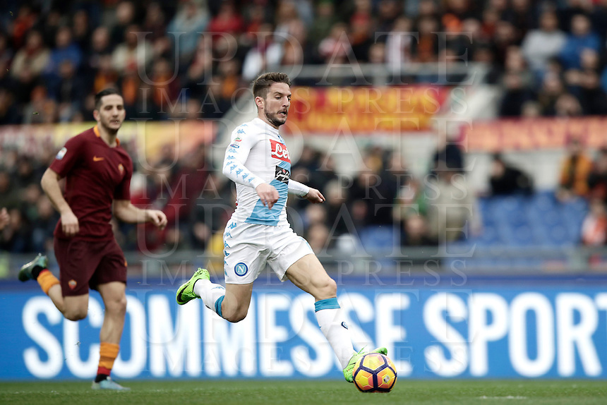 Napoli's Dries Mertens prepares to score his first goal during the Serie A soccer match between Roma and Napoli at the Olympic stadium.<br />  Napoli won 2-1.