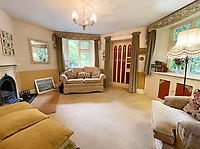 BNPS.co.uk (01202558833)<br /> Pic : Lillicrap Chilcott/BNPS<br /> <br /> A pretty thatched cottage that was the inspiration for a pottery company's ornament of a miniature house has gone on the market for £395,000.<br /> <br /> The idyllic Grade II listed property called East Lodge was once the gatehouse for a country estate near Redruth, Cornwall.<br /> <br /> The 220-year-old property has lots of quirky features with granite walls, a prominent pillared porch and arched glass windows.<br /> <br /> The small bolthole has 650 sq ft of living space with a heptagonal-shaped sitting room, kitchen, side entrance hall and bathroom downstairs and two bedrooms upstairs.