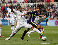 SWANSEA, WALES - MAY 17: Sergio Aguero of Manchester City (C) is stopped by Ashley Williams (L) of Swansea during the Premier League match between Swansea City and Manchester City at The Liberty Stadium on May 17, 2015 in Swansea, Wales. (photo by Athena Pictures/Getty Images)