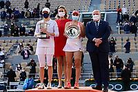 10th October 2020, Roland Garros, Paris, France; French Open tennis, Ladies singles final 2020; Iga Swiatek celebrates after winning the match on the podium with Sofia Kenin usa , Mary Pierce and Bernard Giudicelli president de la FFT