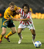 LA Galaxy Fwd John Wolyniec battles for a loose ball against Necaxa Fwd Mario Perez.  Necaxa defeated LA Galaxy 1-0 in an International friendly match at The Home Depot Center in Carson, California, Wednesday July 12, 2006.