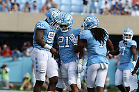 CHAPEL HILL, NC - SEPTEMBER 28: Chazz Surratt #21, Jason Strowbridge #55, and Myles Dorn #1 of the University of North Carolina celebrate after stopping Clemson on third down during a game between Clemson University and University of North Carolina at Kenan Memorial Stadium on September 28, 2019 in Chapel Hill, North Carolina.