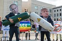 Fotoaktion am Donnerstag den 1. August 2019 vor der US-Botschaft in Berlin, anlaesslich des Ende des INF-Vertrages.<br /> Der Vertrag zum Verbot von Mittelstreckensystemen war seit der Verabschiedung 1988 ein Meilenstein der Abruestung zwischen Russland und den USA. Nach gegenseitigen Vorwuerfen zu Vertragsverletzungen hat US-Praesident Trump am im Oktober 2018 angekuendigt aus dem Vertrag auszusteigen. Der Vertrag endet dementsprechend fristgerecht am 2. August 2019.<br /> Mit der Fotoaktion vor der US-Botschaft am Pariser Platz, verdeutlichten die Friedensorganisationen ICAN Deutschland, IPPNW und DGF-VK, die USA und Russland sollen abzuruesten statt aufruesten.<br /> Im Bild: Demonstranten mit Masken des US-Praesidenten Donald Trump (rechts) und dem russischen Praesidenten Putin (links) bedrohen sich gegenseitig mit Atombomben.<br /> 1.8.2019, Berlin<br /> Copyright: Christian-Ditsch.de<br /> [Inhaltsveraendernde Manipulation des Fotos nur nach ausdruecklicher Genehmigung des Fotografen. Vereinbarungen ueber Abtretung von Persoenlichkeitsrechten/Model Release der abgebildeten Person/Personen liegen nicht vor. NO MODEL RELEASE! Nur fuer Redaktionelle Zwecke. Don't publish without copyright Christian-Ditsch.de, Veroeffentlichung nur mit Fotografennennung, sowie gegen Honorar, MwSt. und Beleg. Konto: I N G - D i B a, IBAN DE58500105175400192269, BIC INGDDEFFXXX, Kontakt: post@christian-ditsch.de<br /> Bei der Bearbeitung der Dateiinformationen darf die Urheberkennzeichnung in den EXIF- und  IPTC-Daten nicht entfernt werden, diese sind in digitalen Medien nach §95c UrhG rechtlich geschuetzt. Der Urhebervermerk wird gemaess §13 UrhG verlangt.]