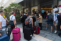 PALMA DE MALLORCA, BALEARIC ISLANDS, SPAIN – JUNE 15: Passengers coming from Dusseldorf, leaving the bus to enter the Hotel Riu, are one of the first tourists to visit Spain since the COVID-19 crisis began. The government of Spain, within the measures of de-escalation and return to new normal, as a result of the COVID-19 crisis, which has kept the entire tourist industry of the country paralyzed for 3 months, has allowed the entry of 10,900 German tourists to the Balearic Islands on 47 flights throughout the entire month of June to test the viability of tourist recovery. The national economy of Spain depends largely of foreign visitors. (Photo by Joan Armengual/VIEWpress via Getty Images).