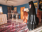 Fr. Ignatius prepares for the First Monastic Liturgy, St. Silhouan Monastery, Columbia, California.