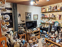 BNPS.co.uk (01202 558833)<br /> Pic: AdamPartridgeAuctioneers/BNPS<br /> <br /> Pictured: The Shurz's living room at the house in Digswell<br /> <br /> A huge collection of pottery and ceramics found stacked inside the suburban home of an elderly couple has sold for almost £200,000.<br /> <br /> Leonard and Alison Shurz filled every room of their three bed house with ceramic pieces they had gathered from all over the world.<br /> <br /> The Aladdin's Cave of pots, bowls, plates, vases and jugs was found by a stunned auctioneer who had the daunting task of cataloguing it all.