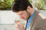 Wine tasting attendee smelling a glass of rose.