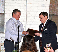 Marc Hayot/Herald Leader Tim McCord (left), accepts the Champion of Youth Award from Boys and Girls Club Director Chris Shimer at the Bill Foreman Hall of Fame Banquet on Nov. 14.