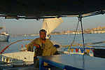 A felucca captain on the River Nile at Luxor.The town of Luxor occupies the eastern part of a great city of antiquity which the ancient Egytians called Waset and the Greeks named Thebes.