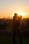 A couple watching the sunset from Olive Hill in East Hollywood, CA