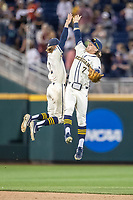 Michigan Wolverines outfielder Jesse Franklin (7) celebrates with teammate Jack Blomgren (2) after beating the Vanderbilt Commodores in Game 1 of the NCAA College World Series Finals on June 24, 2019 at TD Ameritrade Park in Omaha, Nebraska. Michigan defeated Vanderbilt 7-4. (Andrew Woolley/Four Seam Images)