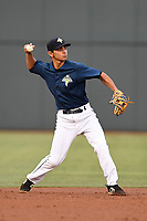 Shortstop Andres Gimenez (13) of the Columbia Fireflies throws out a runner in a game against the Charleston RiverDogs on Monday, August 7, 2017, at Spirit Communications Park in Columbia, South Carolina. Columbia won, 6-4. (Tom Priddy/Four Seam Images)