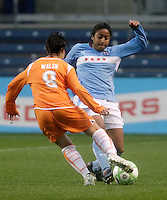 Chicago Fire defender Chioma Igwe (12) takes the ball away from Sky Blue FC forward Sarah Walsh (8).  The Chicago Red Stars tied Sky Blue FC 0-0 at Toyota Park in Bridgeview, IL on April 19, 2009.
