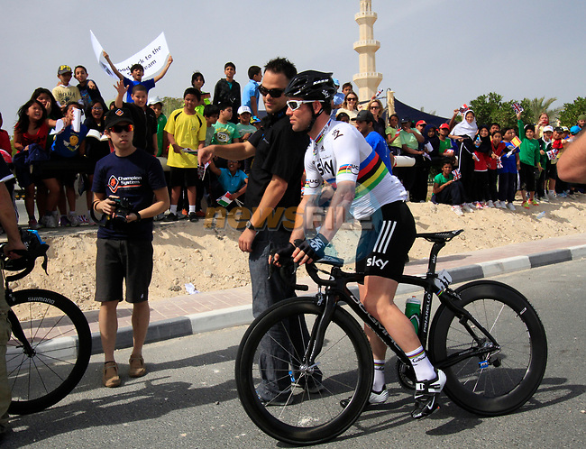 Sky Procycling rider World Champion Mark Cavendish (GBR) passes local school children before the start of the 3rd Stage of the 2012 Tour of Qatar running 146.5km from Dukhan Souq, Dukhan to Al Gharafa, Qatar. 7th February 2012.<br /> (Photo Eoin Clarke/Newsfile)