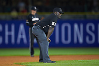 Second base umpire Troy Fullwood stands on the field during the game between the Notre Dame Fighting Irish and the Louisville Cardinals in Game Eight of the 2017 ACC Baseball Championship at Louisville Slugger Field on May 25, 2017 in Louisville, Kentucky. The Cardinals defeated the Fighting Irish 10-3. (Brian Westerholt/Four Seam Images)