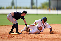 FCL Tigers West Izaac Pacheco (35) is tagged out by shortstop Trey Sweeney (33) while sliding into second base during a game against the FCL Yankees on July 31, 2021 at Tigertown in Lakeland, Florida.  (Mike Janes/Four Seam Images)