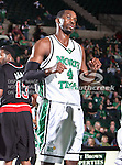 North Texas Mean Green forward George Odufuwa (4) in action during the NCAA  basketball game between the Arkansas State Red Wolves and the University of North Texas Mean Green at the North Texas Coliseum,the Super Pit, in Denton, Texas. UNT defeated Arkansas State 83 to 64..