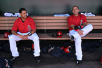 TEMPE - MARCH 10:  Kendry Morales (right) and Juan Rivera of the Los Angeles Angels of Anaheim hang out in the dugout before a spring training game against the Cincinnati Reds on March 10, 2010 at Tempe Diablo Stadium in Tempe, Arizona. (Photo by Brad Mangin)