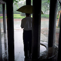 A Chinese man stands in the rain at People's Square in Shanghai in June, 2011. (Mamiya 6, 75mm f3.5, Kodak Ektar 100 film)