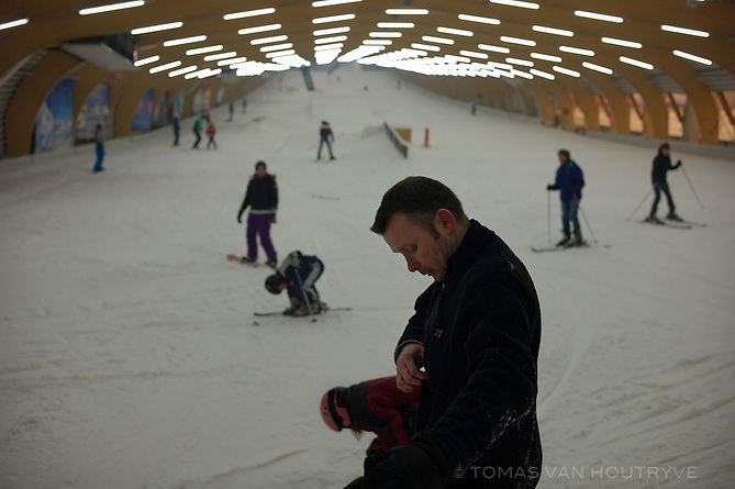 People ski indoors at the Ice Mountain sport center of Comines, Belgium, on February 28, 2013.