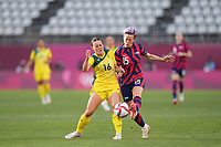 KASHIMA, JAPAN - AUGUST 5: Megan Rapinoe #15 of the United States and Hayley Raso #16 of Australia battles for the ball during a game between Australia and USWNT at Kashima Soccer Stadium on August 5, 2021 in Kashima, Japan.