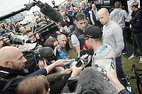 Mark Cavendish (GBR/OmegaPharma-Quickstep) mobbed by the press at the teambus before the stage start.<br /> After a sprint crash (he himself was responsible for) a day earlier, he ruptured his shoulders ligaments and is unable to continue the Tour.<br /> After shortly addressing the press, he will return home later that day.<br /> <br /> 2014 Tour de France<br /> stage 2: York-Sheffield (201km)