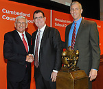Philanthropist Eli Broad, left, and U.S. Secretary of Education Arne Duncan, right, congratulate Houston Independent School District Superintendent Terry Grier after announcing that Houston is the winner of the 2013 Broad Prize for Urban Education, Wednesday, Sept. 25, 2013, at the Library of Congress in Washington, D.C.  As the winner of the award that recognizes the public school district making the greatest performance and improvement gains in student achievement, Houston will receive $550,000 in college scholarships for its high school seniors. The three other finalists—Corona-Norco Unified School District in California, Cumberland County Schools in North Carolina, and the San Diego Unified School District —will each receive $150,000 in college scholarships. (Photo by Diane Bondareff/Invision for The Broad Foundation/AP Images)