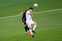 CARSON, CA - JUNE 19: Jorge Villafana #19 of the Los Angeles Galaxy heads a ball during a game between Seattle Sounders FC and Los Angeles Galaxy at Dignity Health Sports Park on June 19, 2021 in Carson, California.