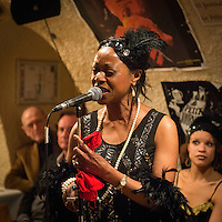 Sylvia Howard (vocal) with Yves Riquet, Jean-Paul Amouroux and Nicolle Rochelle at a jazz concert by the Fantastic Harlem Drivers at the Petit Journal St Michel, Paris, Saturday 19th April 2014. The Fantastic Harlem Drivers consist of pianist Lou Lauprete, clarinetist Alain Marquet, double bass player Bernard Brimeur, and vocalists Sylvia Howard and Nicolle Rochelle, accompanied by tap-dancers Jelly Germain, his son Osiris Germain and Caroline Podetti. Lou Lauprete and Alain Marquet are regulars at Paris Boogie Speakeasy, the  private Parisian jazz club founded and run by Yves Riquet. Sylvia Howard sings with the Duke Ellington orchestra and the Black Label Swingtet, each led by saxophone player Christian Bonnet. Nicolle Rochelle is an internationally known singer, dancer, and actress, the star of Jerome Savary's 'Josephine' which ran for four years in France and Europe, in which Nicolle took the lead role as Josephine Baker. The evening was also attended by Yves Riquet (Sponsor and founder of Paris Boogie Speakeasy) and Jean-Paul Amouroux introduced as the finest player of Boogie-Woogie in Europe. The Fantastic Harlem Drivers were recently recorded for a new CD at Paris Boogie Speakeasy, 256 Rue Marcadet, Paris. Saturday 19th April 2014.
