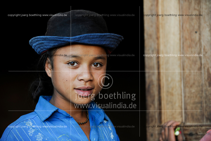 MADAGASCAR Morarano , girl with hat in village / MADAGASKAR Dorf Morarano , Maedchen mit Hut