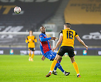 8th January 2021; Molineux Stadium, Wolverhampton, West Midlands, England; English FA Cup Football, Wolverhampton Wanderers versus Crystal Palace; Michy Batshuayi of Crystal Palace turns and heads the ball forward past Conor Coady of Wolverhampton Wanderers
