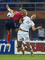 USA forward (20) Abby Wambach goes up for a header against England defender (5) Faye White. The United States (USA) defeated England (ENG) 3-0 during a quarter-final match of the FIFA Women's World Cup China 2007 at Tianjin Olympics Center Stadium in Tianjin, China, on September 22, 2007.