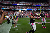 Houston, Texas<br /> October 2, 2011<br /> <br /> Houston Texas players take to the field as the game begins.<br /> <br /> The Houston Texans defeated the Pittsburgh Steelers at the Reliant Stadium 17 to 10.