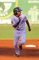 Jackson Generals shortstop Jose Vinicio (20) races to third base during a Southern League game against the Biloxi Shuckers on July 26, 2018 at The Ballpark at Jackson in Jackson, Tennessee. Jackson defeated Biloxi 9-5. (Brad Krause/Four Seam Images)