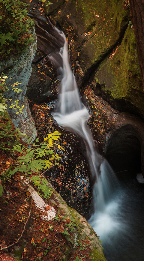 A small waterfall where Skillet Creek cuts through Pewit's Nest near Baraboo, Wisconsin