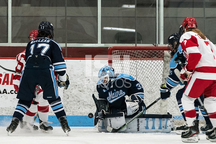 BOSTON, MA - JANUARY 04: Carly Jackson #33 of University of Maine save during a game between University of Maine and Boston University at Walter Brown Arena on January 04, 2020 in Boston, Massachusetts.