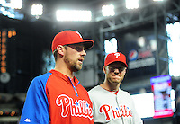 Apr. 25, 2012; Phoenix, AZ, USA; Philadelphia Phillies pitchers Cliff Lee (left) and Roy Halladay walk off the field following the game against the Arizona Diamondbacks at Chase Field. Mandatory Credit: Mark J. Rebilas-