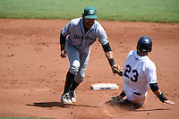 Daytona Tortugas shortstop Alex Blandino (5) tags out Jake Bauers (23) during a game against the Charlotte Stone Crabs on April 14, 2015 at Charlotte Sports Park in Port Charlotte, Florida.  Charlotte defeated Daytona 2-0.  (Mike Janes/Four Seam Images)