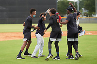 FCL Yankees Madison Santos (34) high fives teammates after hitting a walk-off double during a game against the FCL Phillies on July 6, 2021 at the Yankees Minor League Complex in Tampa, Florida.  (Mike Janes/Four Seam Images)