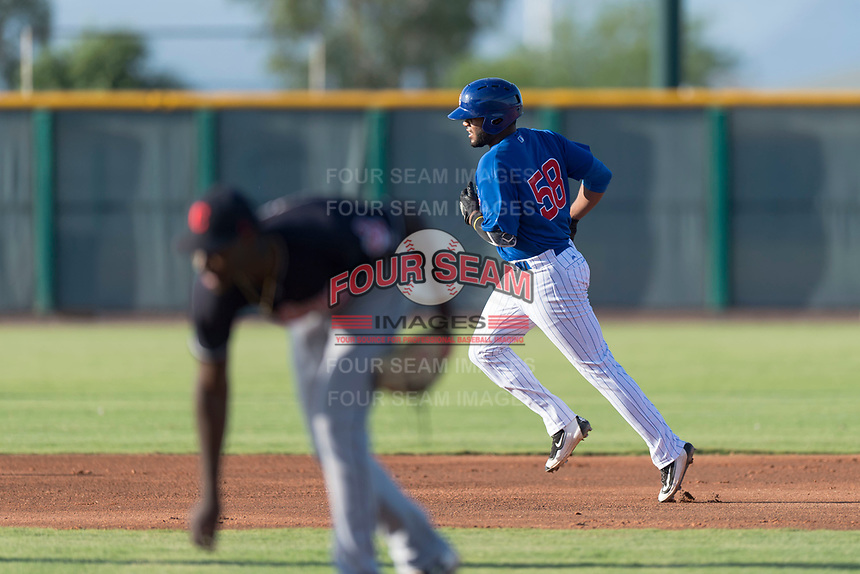 AZL Cubs 1 first baseman Rafael Mejia (58) rounds the bases after hitting a home run during an Arizona League game against the AZL Indians 1 at Sloan Park on August 27, 2018 in Mesa, Arizona. The AZL Cubs 1 defeated the AZL Indians 1 by a score of 3-2. (Zachary Lucy/Four Seam Images)