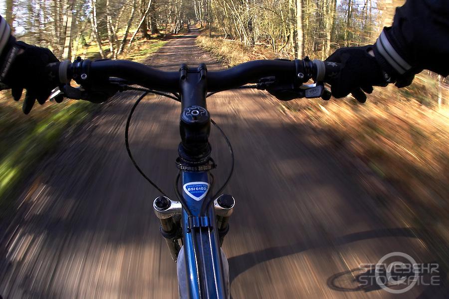riders eye view of trail and bike handlebars.virginia Water Surrey January 2008.pic copyright Steve Behr / Stockfile