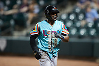 Jose Acosta (2) of the Llamas de Hickory is all smiles after scoring a run during the game against the Winston-Salem Rayados at Truist Stadium on July 6, 2021 in Winston-Salem, North Carolina. (Brian Westerholt/Four Seam Images)