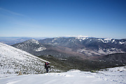 Hiker traveling south on the Appalachian Trail (Franconia Ridge Trail), on Franconia Ridge, in the New Hampshire White Mountains during the winter months.