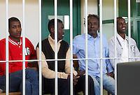 Da sinistra, Mohamed Isse Karshe, Abdi Hassan Mahamur, Ahmed Malimed Ali, Abdullahi Ali Ahmed, presunti pirati somali accusati dell'attacco alla nave portacontainer italiana Montecristo, durante la prima udienza del processo presso la III Corte d'Assise a Roma, 23 marzo 2012. La nave, assaltata il 10 ottobre 2011 al largo della Somalia, venne liberata il 15 ottobre dai Royal Marines britannici con l'ausilio di una nave militare statunitense..Somali allegedly pirates, from left, Mohamed Isse Karshe, Abdi Hassan Mahamur, Ahmed Malimed Ali and Abdullahi Ali Ahmed, sit inside a cage during the opening audience for the assault to the Montecristo container ship, in Rome, 23 march 2012. The ship was attacked on 10 october 2011 and freed by US navy and British Royal Marines on 15 october..UPDATE IMAGES PRESS/Riccardo De Luca