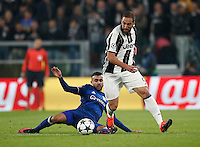 Calcio, Champions League: Gruppo H, Juventus vs Lione. Torino, Juventus Stadium, 2 novembre 2016. <br /> Juventus' Gonzalo Higuain, left, is tackled by Lyon's Rachid Ghezzal during the Champions League Group H football match between Juventus and Lyon at Turin's Juventus Stadium, 2 November 2016. The game ended 1-1.<br /> UPDATE IMAGES PRESS/Isabella Bonotto