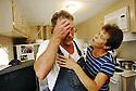 Donald and Colleen Bordelon in FEMA trailer outside of their Arabi home, 2006.