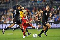 Canada forward Kelly Parker (15) goes pass Carli Lloyd (10) watched byLauren Cheney (12).